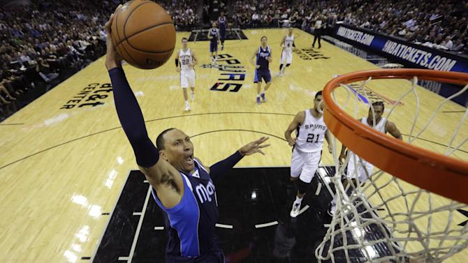 FILE - In this April 23, 2014, file photo, Dallas Mavericks' Shawn Marion, left, drives to the basket over San Antonio Spurs' Tony Parker (9) during the first half of Game 2 of the opening-round NBA basketball playoff series on in San Antonio. A person familiar with the negotiations says veteran free agent forward Shawn Marion has agreed to a contract with the Cleveland Cavaliers. Marion informed the Cavs this weekend that he will take a minimum deal and play for them next season, said the person who spoke Sunday, Aug. 17, 2014, to The Associated Press on condition of anonymity because the contract has not been finalized. (AP Photo/Eric Gay, File)
