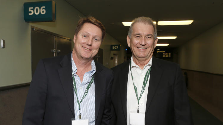 Autoweek Senior Editor Mark Vaughn and Edmunds.com Senior Editor John O'Dell attend a California Electric Transportation Coalition VIP Tour at the Los Angeles Auto Show on Monday Dec 3, 2012, in Los Angeles. (Photo by Todd Williamson/Invision for Better World Group/AP Images)