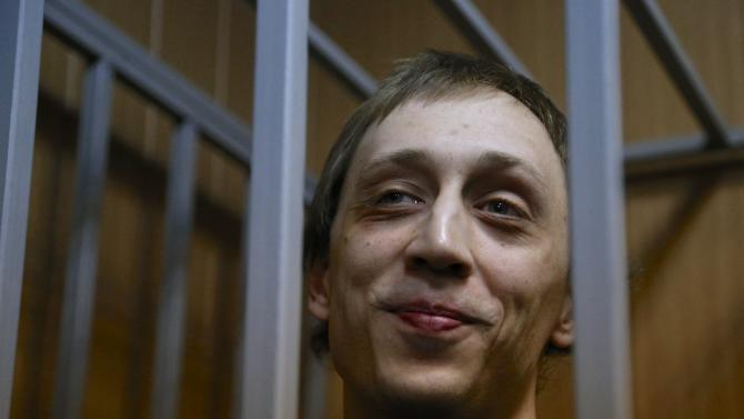 In this photo taken on Tuesday, Oct. 22, 2013, Pavel Dmitrichenko stands in a cage at a court room . Bolshoi ballet dancer Pavel Dmitrichenko, who is accused of being behind an acid attack against Bolshoi's artistic director Sergei Filin, pleaded not guilty to the charges of plotting the assault on Tuesday, Oct. 29, 2013. (AP Photo/Alexander Zemlianichenko)
