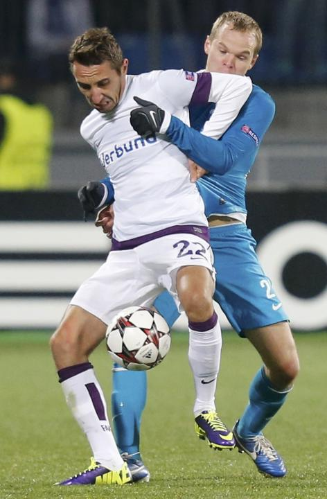 Zenit St.Petersburg's Anyukov fights for the ball with Austria Wien's Leovac during their Champions League soccer match at the Petrovsky stadium in St. Petersburg