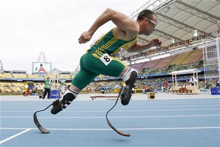 Oscar Pistorius of South Africa comes out of the starting blocks during his men's 400 metres heats at the IAAF World Championships in Daegu August 28, 2011. REUTERS/Max Rossi