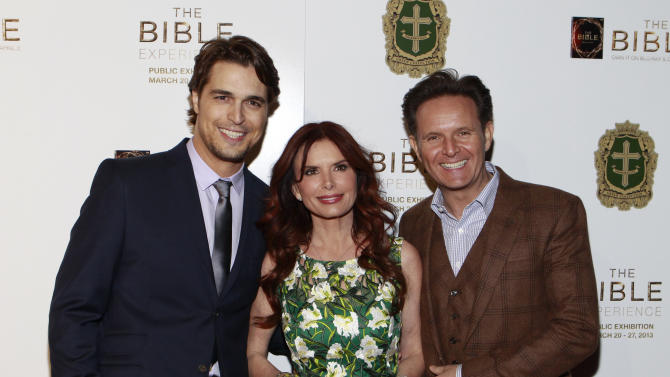 IMAGE DISTRIBUTED FOR FOX HOME ENTERTAINMENT - From left, Actors Diogo Morgado, Roma Downey, and Producer Mark Burnett  pose on the red carpet to celebrate theApril 2Blu-ray, DVD, and Digital HD releaseof THE BIBLEfrom Twentieth Century Fox Home Entertainment at The Bible Experience, a rare exhibit of biblical artifacts, in New York on Tuesday, March 19, 2013. (Photo by Mark Von Holden/Invision for Fox Home Entertainment/AP Images)