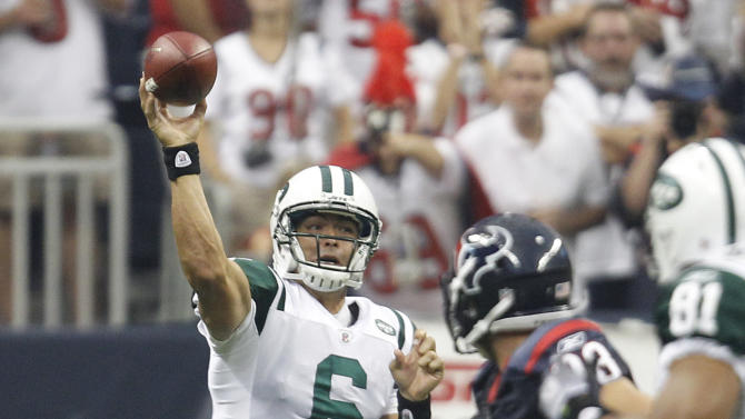New York Jets quarterback Mark Sanchez (6) throws a pass under pressure from Houston Texans defensive end Connor Barwin (98) during the first quarter of an NFL preseason football game Monday, Aug. 15, 2011, in Houston. (AP Photo/Eric Gay)