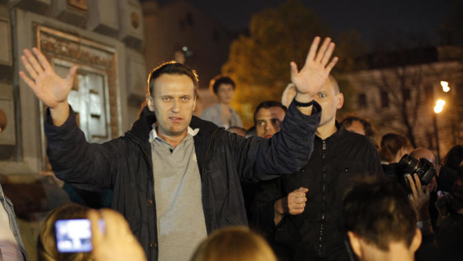 FILE - In this Tuesday, May 8, 2012 file photo, Alexei Navalny, a prominent anti-corruption whistle blower and blogger speaks to protesters gathered near the presidential administrations building in downtown Moscow, a day after Putin's inauguration as president. An Associated Press-GfK poll has shown that 60 percent of Russians still maintain a favorable opinion of Putin, who won a third presidential term in March's election despite massive protests in Moscow against his rule. (AP Photo/Alexander Zemlianichenko Jr,file)