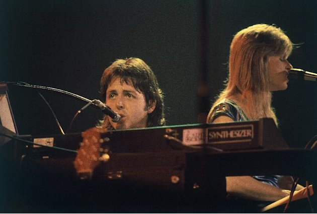 FILE - In this May 9, 1976 file photo, Paul McCartney and his wife Linda McCartney perform in concert at Maple Leaf Gardens in Toronto along with their band Wings. McCartney turned 70 years of age Mon