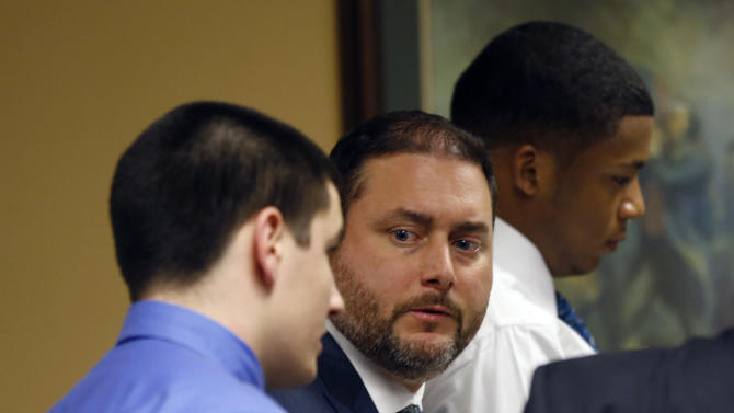 From left, defendant Trent Mays, 17, his defense attorney Adam Nemann, and co-defendant ,16-year-old Ma'lik Richmond get up to leave their trial on rape charges more than 13 hours after the start of their third day in juvenile court on Friday, March 15, 2013 in Steubenville, Ohio. Mays and Richmond are accused of raping a 16-year-old West Virginia girl in August 2012. (AP Photo/Keith Srakocic, Pool)