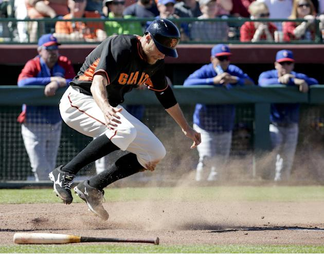 San Francisco Giants' Michael Morse celebrates after scoring on a two-run single by Pablo Sandoval during the fourth inning of a spring exhibition baseball game against the Chicago Cubs in Scottsd