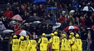 Australia players leave the field for a rain delay during the fifth One Day Cricket match between England and Australia at Old Trafford in Manchester. England routed Australia by seven wickets to complete a 4-0 series win