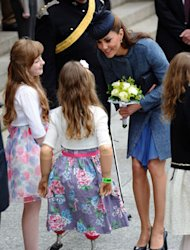 The Duchess of Cambridge looks regal in navy tweed
