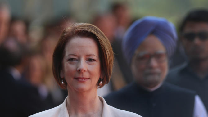 Australian Prime Minister Julia Gillard, arrives with her Indian counterpart Manmohan Singh, at the Indian Presidential palace for ceremonial reception, in New Delhi, India , Wednesday, Oct. 17, 2012.  (AP Photo/ Manish Swarup)