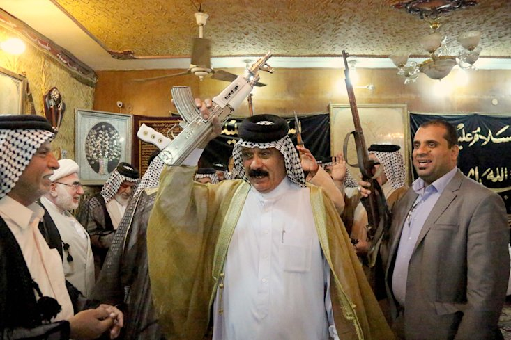 CLICK IMAGE for slideshow: Iraqi Shiite tribal leaders chant slogans against the al-Qaida-inspired Islamic State of Iraq and the Levant (ISIL), in Baghdad, Iraq, Friday, June. 13, 2014. The tribal leaders met in Sadr city on Friday and declared their readiness along with their tribesmen to take up arms against the al-Qaida inspired group that had in Iraq's made advance Sunni heartland.(AP Photo/ Karim Kadim)