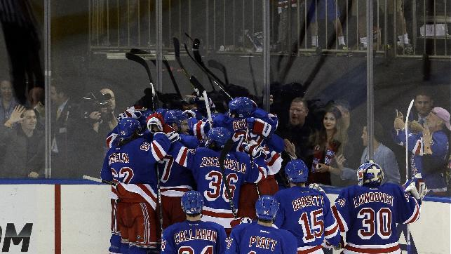 The New York Rangers celebrate a goal by Chris Kreider after the overtime period in Game 4 of the Eastern Conference semifinals in the NHL hockey Stanley Cup playoffs against the Boston Bruins, Thursday, May 23, 2013, in New York. The Rangers won the game 4-3. (AP Photo/Frank Franklin II)