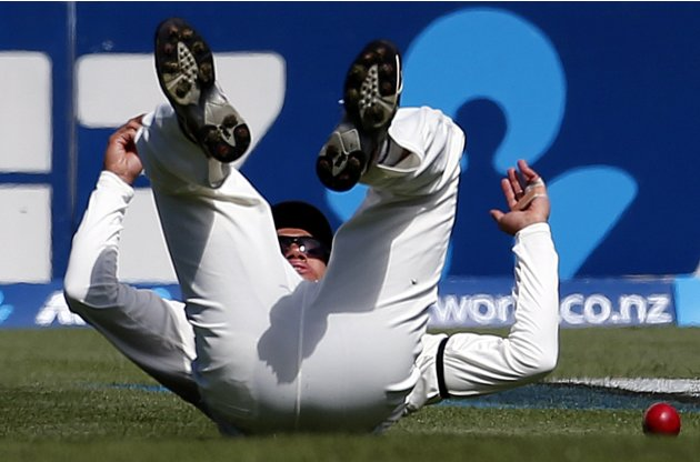 New Zealand's Taylor lies on the field after almost taking a catch to dismiss England's Trott during the second day of the first test in Dunedin