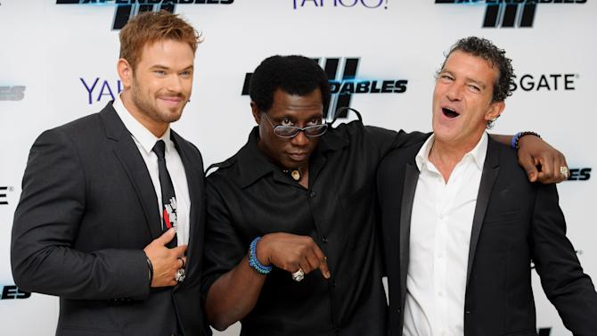 From left, U.S actors Kellan Lutz, Wesley Snipes and Spanish actor Antonio Banderas gesture as they pose for photographers at the World Premiere of The Expendables 3 at a central London cinema, Monday, Aug. 4, 2014. (Photo by Jonathan Short/Invision/AP)
