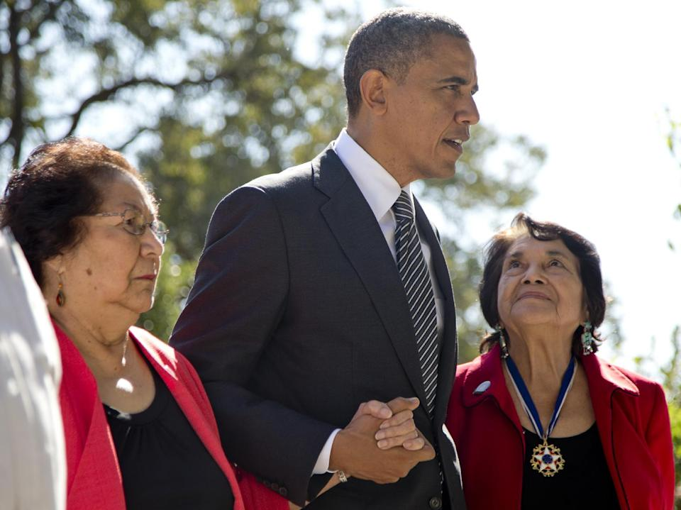 President Barack Obama walks with Cesar Chavez' widow Helen F. Chavez,  left, and Dolores Huerta, Co-Founder of the United Farm Workers, as they tour the Cesar E. Chavez National Monument Memorial Garden, Monday, Oct. 8, 2012, in Keene, Calif. (AP Photo/Carolyn Kaster)