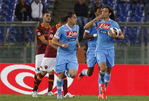 Napoli forward Edinson Cavani, of Uruguay, right, celebrates after scoring during a Serie A soccer match between AS Roma and Napoli, at Rome's Olympic stadium, Sunday, May 19, 2013.  AS Roma won 2-1