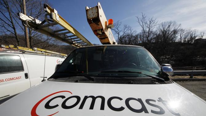 In this Tuesday, Feb. 15, 2011, photo, a Comcast logo is seen on a Comcast truck in Pittsburgh. Comcast Corp. reports quarterly financial results before the market opens on Wednesday, July 31, 2013. (AP Photo/Gene J. Puskar)