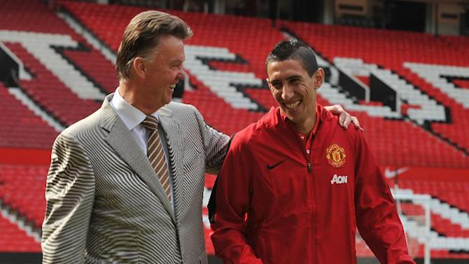Manchester United manager Louis van Gaal (L) with newly-signed Angel di Maria during an official presentation at Old Trafford in Manchester on August 28, 2014