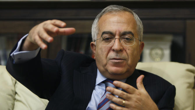 Palestinian Prime Minister Salam Fayyad gestures during an interview with The Associated Press in the West Bank city of Ramallah, Sunday, Jan. 6, 2013. Fayyad is blaming Arab countries that haven't delivered promised financial aid for an escalating financial crisis in the Palestinian territories. In an interview Sunday Fayyad said that the cash crunch is pushing an additional 25 percent of the Palestinian population, or 1 million people, into poverty. (AP Photo/Majdi Mohammed)