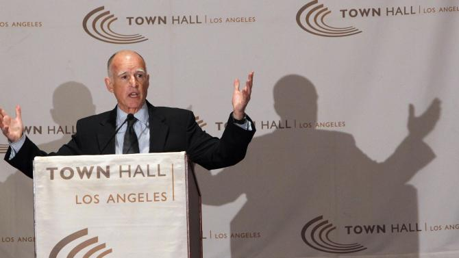 Gov. Jerry Brown warns of painful cuts in Sacramento unless voters approve his $6 billion-a-year tax increase as he speaks in Los Angeles on Wednesday, Oct. 31, 2012. Recent polling has found Proposition 30 in danger of failing in Tuesday's election. (AP Photo/Nick Ut)