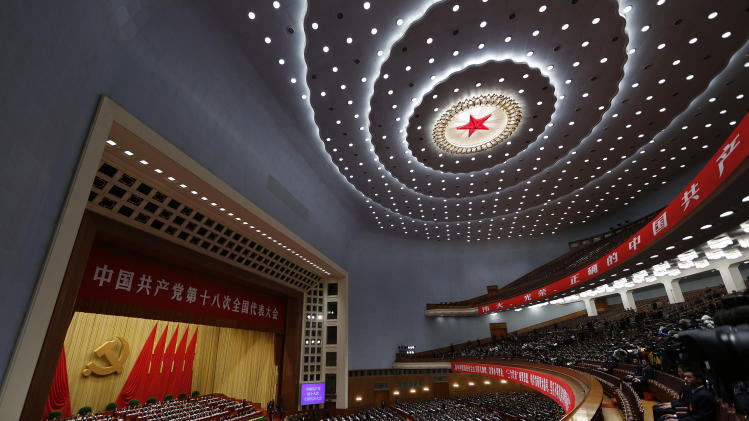 Delegates attend the closing ceremony for the 18th Communist Party Congress at the Great Hall of the People in Beijing Wednesday Nov. 14, 2012. (AP Photo/Vinecnt Yu)