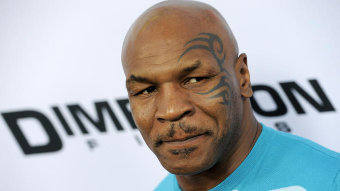 """FILE - This April 11, 2013 file photo shows Mike Tyson, a cast member in """"Scary Movie V,"""" at the Los Angeles premiere of the film in Los Angeles. Adult Swim says it's turning Mike Tyson into a cartoon detective. The young-adult network has announced a new animated series, """"Mike Tyson Mysteries,"""" that will feature the retired boxing champ. (Photo by Chris Pizzello/Invision/AP, file)"""