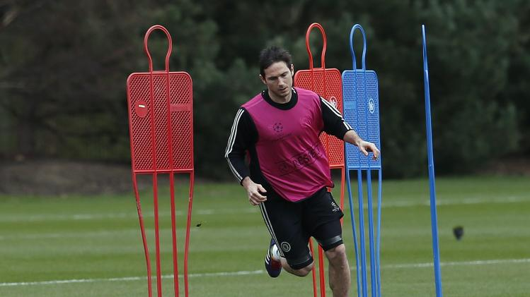 Chelsea's Lampard runs during a team training session at their training ground in Cobham, southern England