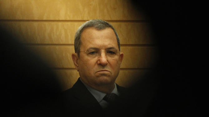 "FILE - In this Feb. 15, 2012 Israeli Defense Minister Ehud Barak is seen between reporters before a meeting with Japanese Prime Minister Yoshihiko Noda at the latter's official residence in Tokyo. He's been prime minister, military chief, Israel's most decorated soldier and, for the past five years, its defense minister and moderate face to the West. But Ehud Barak's long and distinguished career in public service may be coming to an end. He is widely unpopular with the general public, with polls showing his ""Independence"" Party will, at best, garner barely a few seats in the next parliament. (AP Photo/Issei Kato, Pool, File)"