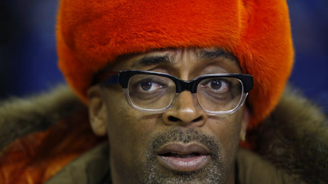 "U.S. movie director Spike Lee speaks as he is interviewed by members of the media before a New York Knicks training session at the 02 arena in London, Wednesday, Jan. 16, 2013.  The Detroit Pistons are due to play a ""home"" NBA league game against the New York Knicks at the arena on Thursday. (AP Photo/Matt Dunham)"