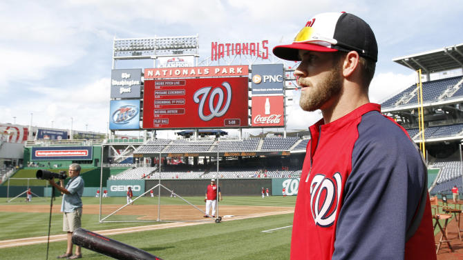 Washington Nationals left fielder Bryce Harper carries his bat to batting practice before a baseball game against the Milwaukee Brewers at Nationals Park Monday, July 1, 2013, in Washington. (AP Photo/Alex Brandon)