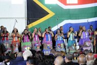 "South African dancers perform at a Social Cohesion Summit in Kliptown, Soweto. After the end of apartheid, ""the focus was on building the country... and the people were left behind,"" Futhi Mtoba, the black chairwoman of Business Unity South Africa, said at a social cohesion forum"