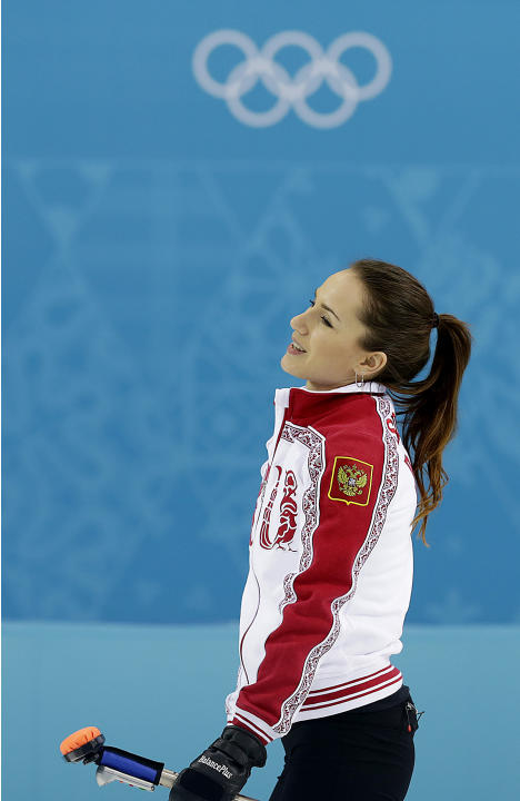 Russia's Anna Sidorova smiles after delivering the rock during the women's curling competition against China at the 2014 Winter Olympics, Tuesday, Feb. 11, 2014, in Sochi, Russia. (AP Photo/Wo