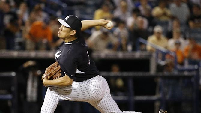 New York Yankees starting pitcher Masahiro Tanaka, pitching in relief for countryman Hiroki Kuroda, delivers in a spring exhibition baseball game against the Miami Marlins in Tampa, Fla., Friday, March 28, 2014. The Yankees defeated the Marlins 3-0.(AP Photo/Kathy Willens)