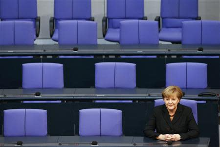 German Chancellor Merkel sits in the Bundestag, lower house of parliament, after she was sworn-in, in Berlin