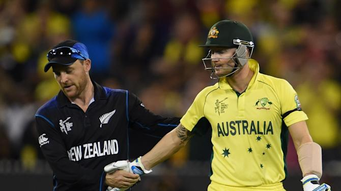 Australia's batsman Michael Clarke (R) shakes hands with New Zealand's captain Brendon McCullum in Melbourne on March 29, 2015