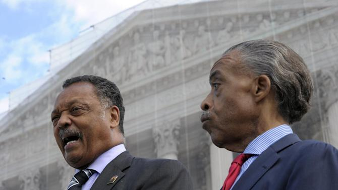 Rev. Jesse Jackson, left, and Rev. Al Sharpton, right, speak to reporters outside the Supreme Court in Washington, Wednesday, Oct. 10, 2012. The Supreme Court is taking up a challenge to a University of Texas program that considers race in some college admissions. The case could produce new limits on affirmative action at universities, or roll it back entirely. (AP Photo/Susan Walsh)