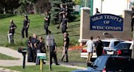 Law enforcement personnel walk outside the Sikh Temple of Wisconsin where a gunman fired upon people at a service on August, 5, 2012 Oak Creek, Wisconsin. India's ambassador to the United States has mourned the killings of Sikhs at a temple in Wisconsin, praising the community as showing the best qualities of Indian Americans