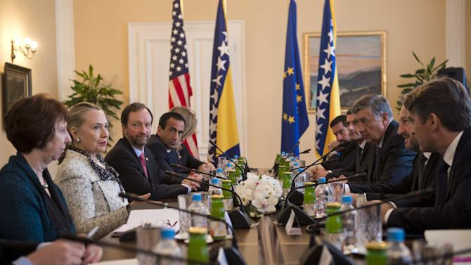 US Secretary of State Hillary Clinton, second left, and High Representative for EU Foreign Policy Catherine Ashton, left, meet with Chairman Bakir Izetbegovic, second right, Nebojsa Radmanovic, third right, and Zeljko Komsic, right, members of the Bosnia and Herzegovina Tri-Presidency, at the Presidency in Sarajevo, Bosnia, Tuesday, Oct. 30, 2012. The top American and European diplomats are on a joint diplomatic tour of the Balkans, urging rival ethnic groups and governments in Bosnia, Serbia and Kosovo to settle their differences for the good of their nations. U.S. Secretary of State Hillary Rodham Clinton was talking Tuesday with European Union foreign policy chief Catherine Ashton in the Bosnian capital of Sarajevo. They are then meeting together with Bosnia's three presidents before travelling to Belgrade for similar talks with Serbian leaders. Clinton and Ashton will see Kosovo's leaders on Wednesday. (AP Photo/Saul Loeb, Pool)