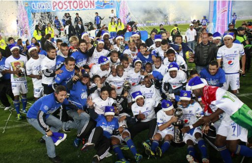 Millonarios players and fans celebrate winning the Colombian First Division soccer