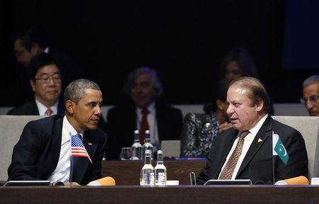 U.S. President Obama listens to Pakistan's PM Sharif during the opening session of the Nuclear Security Summit in The Hague