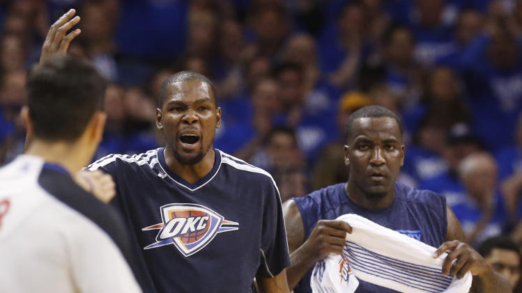 Oklahoma City Thunder forward Kevin Durant, left, reacts on the bench during the first quarter of Game 1 of a first-round NBA basketball playoff series against the Houston Rockets in Oklahoma City, Sunday, April 21, 2013. Thunder center Kendrick Perkins watches at right. (AP Photo/Sue Ogrocki)