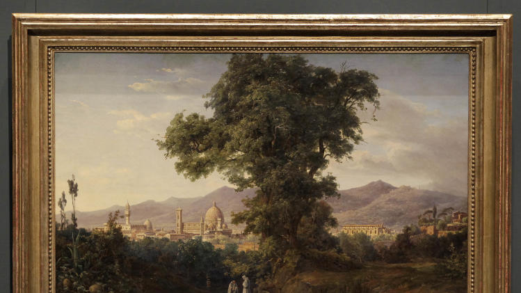 The painting 'View of Florence' by painter August Wilhelm Julius Ahlborn that was borrowed by the Old National Gallery to decorate the apartment of Adolf Hitler is displayed in Berlin, Germany, Thursday, Dec. 9, 2010 during an exhibition of paintings that got lost after World War II and have recently been returned to Berlin. (AP Photo/Michael Sohn)