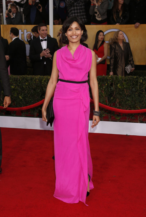 Freida Pinto arrives at the 19th Annual Screen Actors Guild Awards at the Shrine Auditorium in Los Angeles on Sunday Jan. 27, 2013. (Photo by Todd Williamson/Invision for The Hollywood Reporter/AP Ima