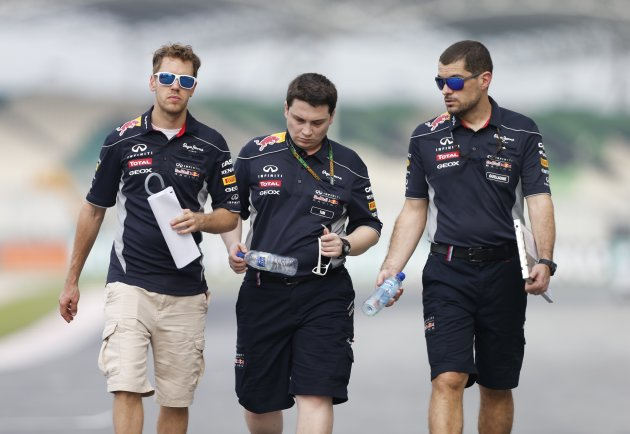 Red Bull Formula One driver Vettel walks the track with crew members at Sepang circuit outside Kuala Lumpur