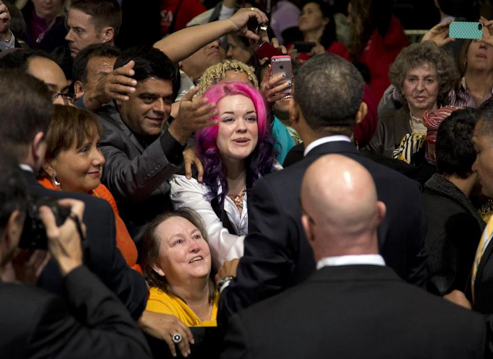 President Barack Obama shakes hands after speaking about immigration at Del Sol High School, Tuesday, Jan. 29, 2013, in Las Vegas. (AP Photo/Carolyn Kaster)