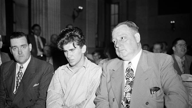 "FILE - In this July 2, 1946 file photo, William Heirens, center, a 17-year-old University of Chicago student, sits in a Chicago courtroom being questioned in connection with slaying of 6-year-old Suzanne Degnan. He is flanked by Chief of Detectives Walter Storms, right, and police Sgt. Tim O'Donnell. Heirens, who was dubbed the ""Lipstick Killer"" after three murders in Chicago in the 1940s and who became Illinois longest-serving inmate, died Monday, March 5, 2012, at a Chicago hospital. He was 83. (AP Photo, File)"