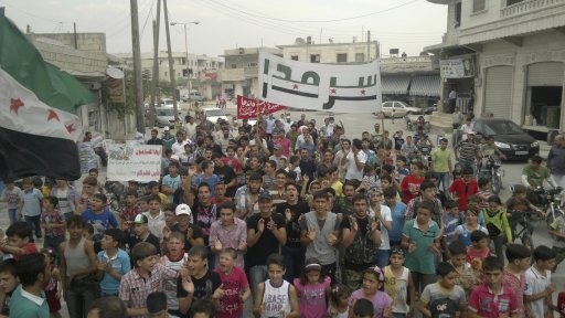 Residents protest against Syria's President Assad in Sermada near Idlib