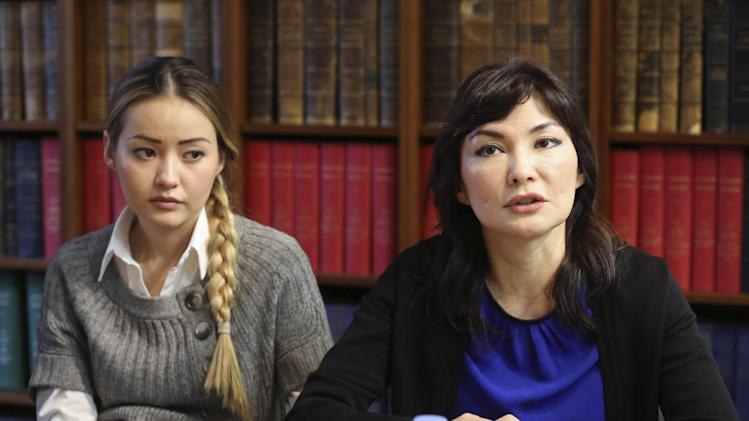Mukhtar Ablyazov's wife Alma Shalabayeva, right, and daughter Madina Ablyazova, left, speak with journalists, during a press conference held with her lawyers, in Paris, Tuesday Jan. 7, 2014. An opposition leader from a country that has been ruled by the same man since 1989, a former banker accused of siphoning off billions, Mukhtar Ablyazov has been jailed since police special forces seized him July 31 in the south of France. (AP Photo/Remy de la Mauviniere)