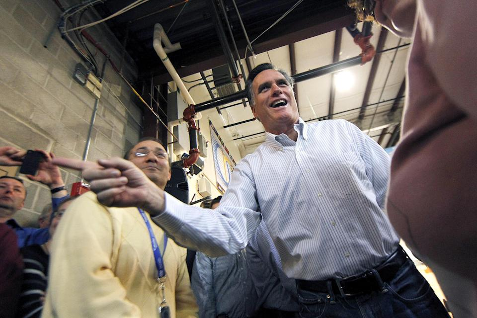 Republican presidential candidate, former Massachusetts Gov. Mitt Romney greets employees at Meridian Bioscience, in Cincinnati, Ohio, Monday, Feb. 20, 2012. (AP Photo/Gerald Herbert)