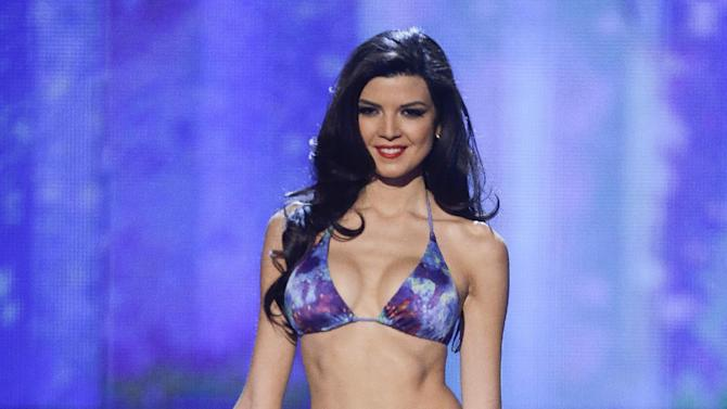 Miss Peru, Nicole Faveron, walks the stage during the swimsuit portion of the Miss Universe competition, Wednesday, Dec. 19, 2012, in Las Vegas. (AP Photo/Julie Jacobson)